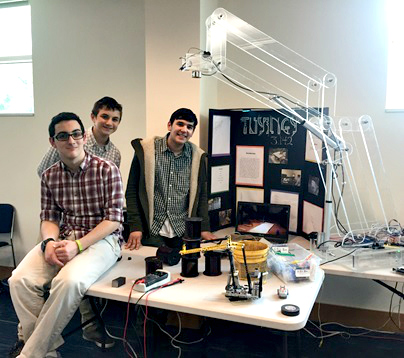 (l-r): YUHSB's Hanan Berger, Benny Jacob and GJ Neiman with the robotic arm they built together.