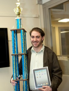 Alon Melzter, Now You Know contest winner, presented with an iPad and trophy.