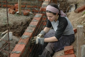 Laying bricks for library's foundation in Nicaragua.