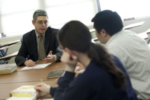 Prof. Itay Zutra, left, helps design lesson plans for the Yiddish Club.