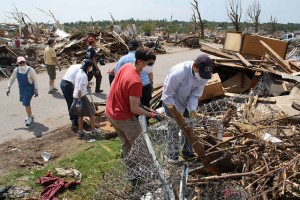 Students on the Kansas City Summer Experience help with disaster clean-up efforts in Joplin, MO.