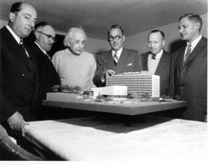 In 1953, Albert Einstein views a model of the Yeshiva University medical school in the Bronx which bears his name.