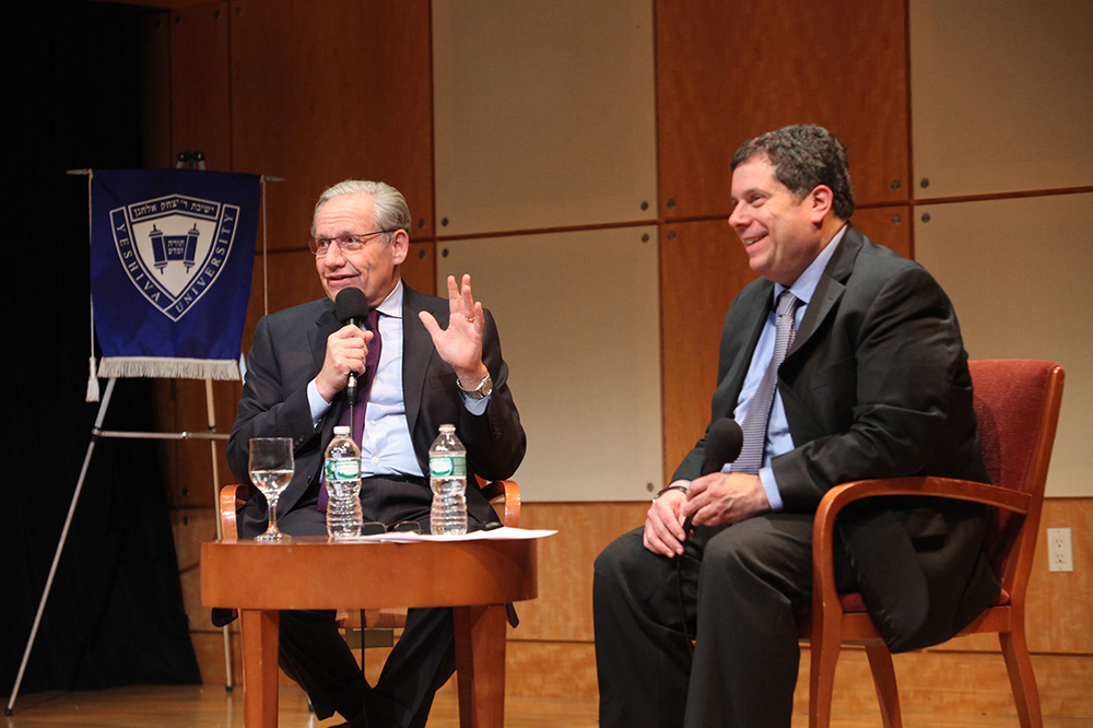 Bob Woodward, left, and Dr. Bryan Daves discuss the political climate in Washington.