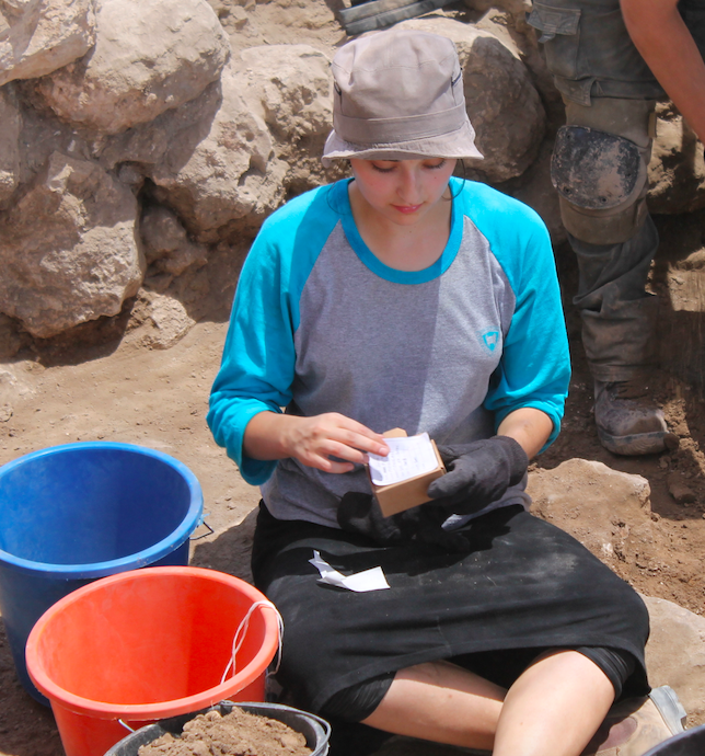 Sima Fried, an anthropology student at Stern College for Women, labels a box at the dig.