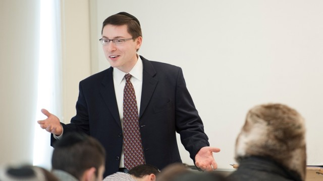 Dr. Eliezer Schnall teaches into the psychology class at Yeshiva College