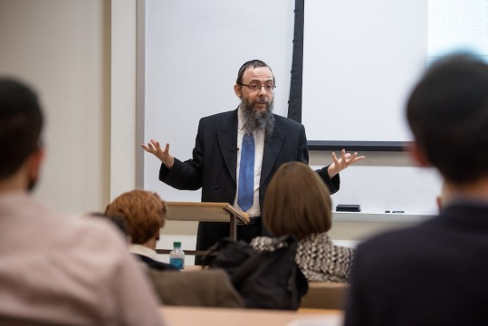 "In a lecture on the history of ""The Forged Yerushalmi,"" Boruch Oberlander told a fascinating story about history and personalities involved when the supposedly lost tractates of Seder Kodashim suddenly appeared in Hungary in 1907, courtesy of a forger by the name of Shlomo Yehuda Algazi-Friedlaender"