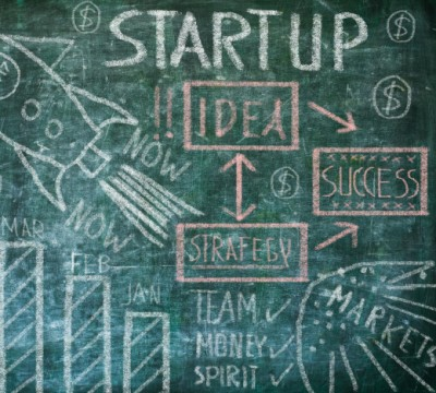drawing Startup concept on chalkboard, free copy space