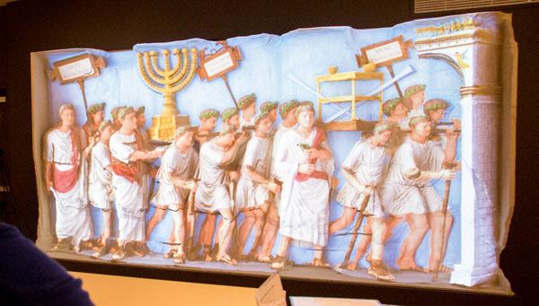 Digitally projected colors on the replica of the Arch of Titus