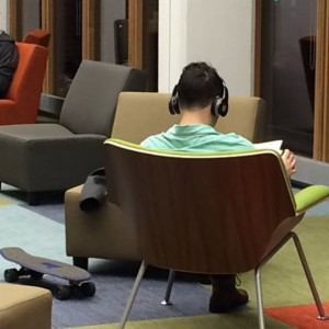 Skateboarding student settles in for an evening of exam preparation in newly renovated Pollack-Gottesman Library