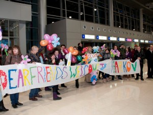 Members of the Kharkov Jewish community greet the YU group at the airport.
