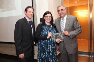 Rabbi Joseph and President Joel present Elysia Stein, longtime coordinator of the program, with the Presidential Fellowship Exemplar of Excellence Award.