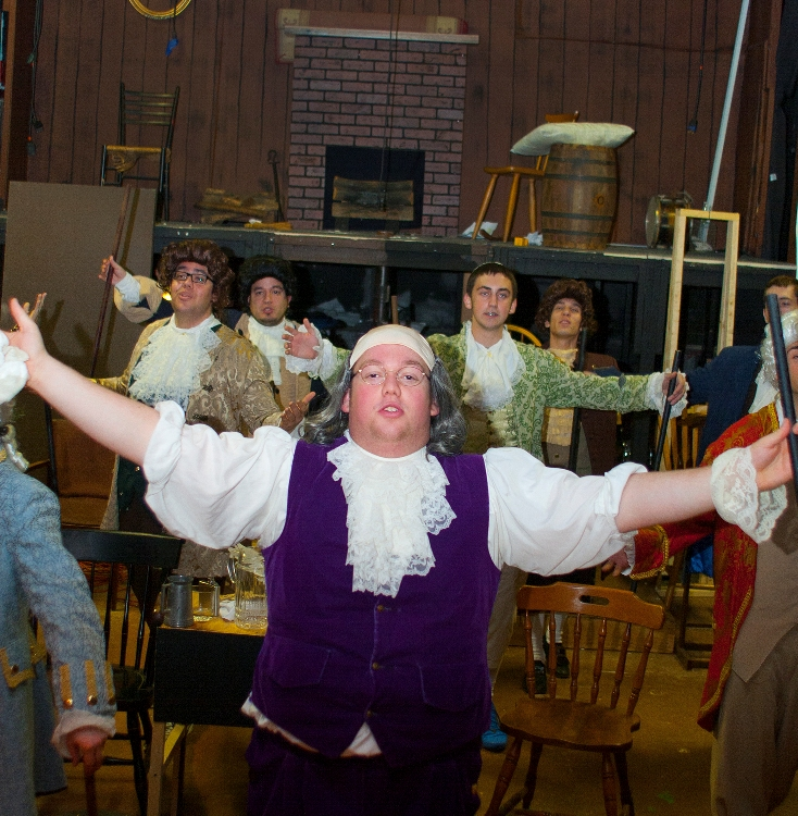 The cast of 1776 rehearses a musical number.