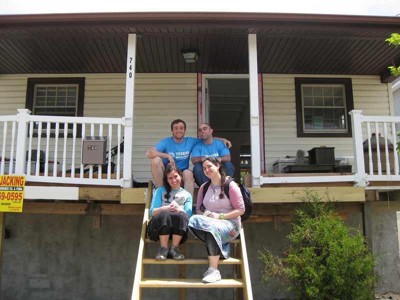 YU students prime and paint Lindenhurst house damaged by Sandy