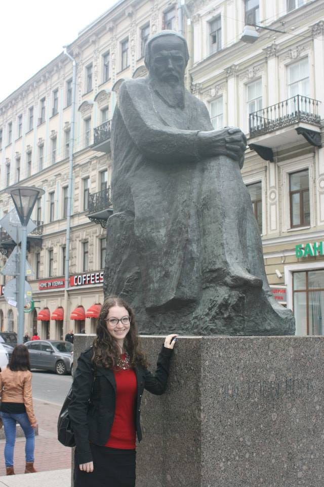 Hannah Rozenblat, a Stern College for Women alum who participated on the trip, with a statue of Fyodor Dostoevsky