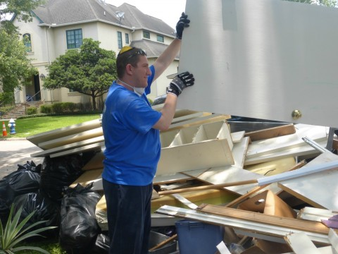 Student Daniel Geller disposes of debris