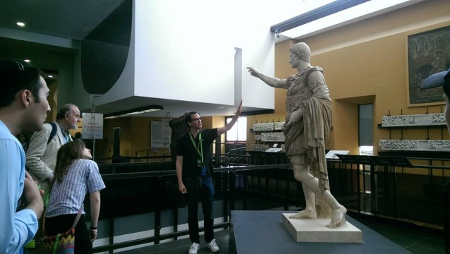 Professor Marnin Young speaks about a statue at the Vatican Museums.
