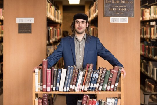 Portrait of Gabriel Wasserman, a Revel student who is graduating this year, whom is being highlighted this year for his accomplishments. Among them, he has written a Haggadah.