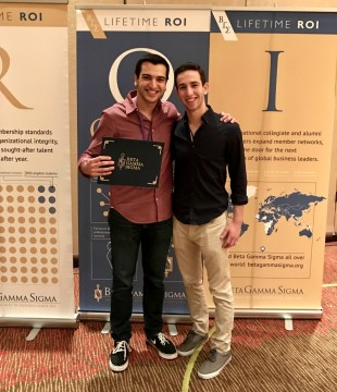 Matan Horenstein, left, and Dov Herzberg represented Sy Syms at the Beta Gamma Sigma Summit