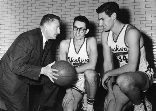 "Coach Bernard ""Red"" Sarachek, left, with Yeshiva basketball players"