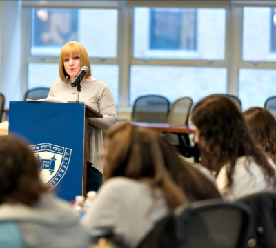 Nechama Price, director of GPATS, speaks at a Yom Iyun on the Beren Campus