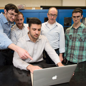Daniel Lazarev (at computer) with Dr. Fredy Zypman (second from right) and fellow students.