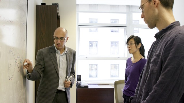 Dr. Marian Gidea, left, with doctoral students Wai-Ting Lam and Maxwell Musser