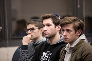 YU students attending Kristallnacht comemoration