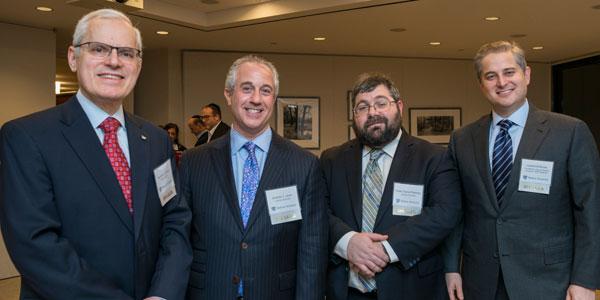 (l-r): Seymour Liebman, Andrew J. Lauer, Rabbi Daniel Feldman, Lawrence Burian