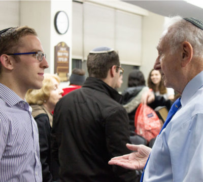 Student Speaks with Norbert Strauss at Kristallnacht Event