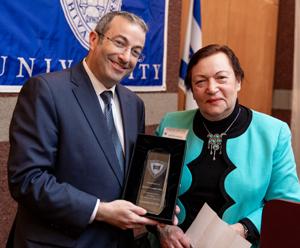 Edith Lubetski Receives Award from Dr. Ari Berman