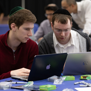 Two students work with AdaCore programming language