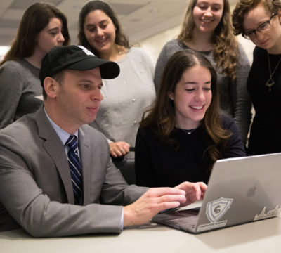 Assemblymember Dan Quart gets a lesson in coding from Zoe Abboudi '20S