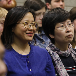 Two women in the audience of the lecture by Dr. Roger Ames