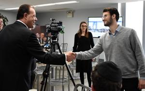 Mark Gjoanj greets student
