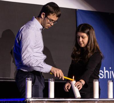 Lighting one of the six candles on Yom HaShoah