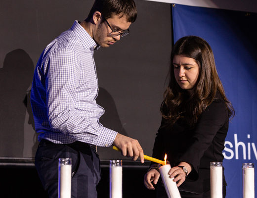 Lighting one of the six candles on Yom HaShoah