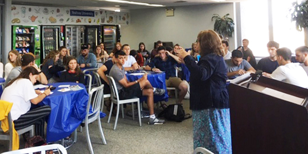 Rona Novick talks to EIN Prat students
