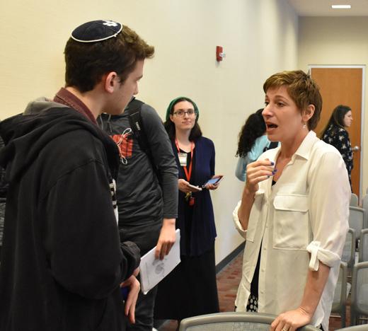 Dr. Nora Nachiumi speaks with Frisch student