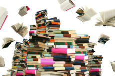 Books flying into the air from a pile of books