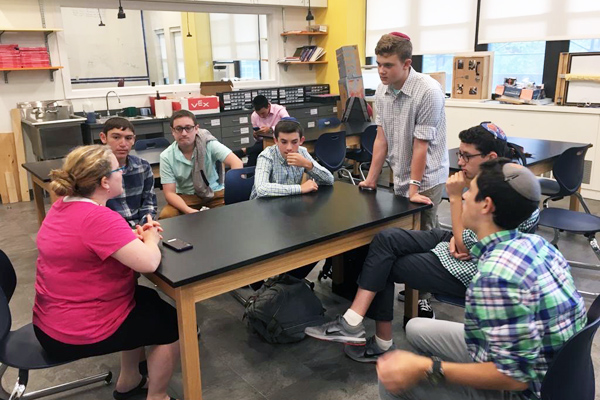 MTA Engineering concentration students meet with their teacher