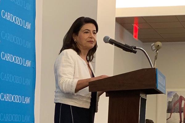 Senator Anna Caplan at lectern