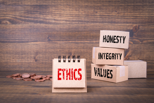 Ethics concept. Honesty, integrity and values words. Paper boxes on wooden background