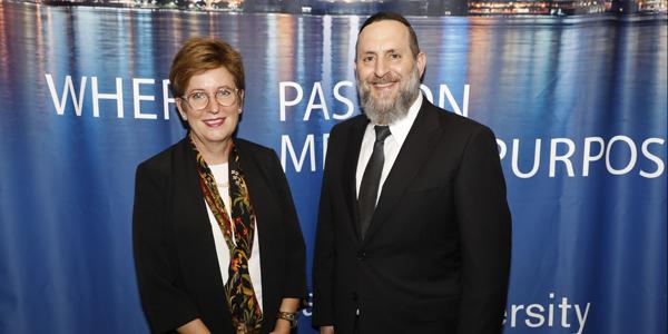 Danielle Wozniak and Rabbi Elazer Meisels