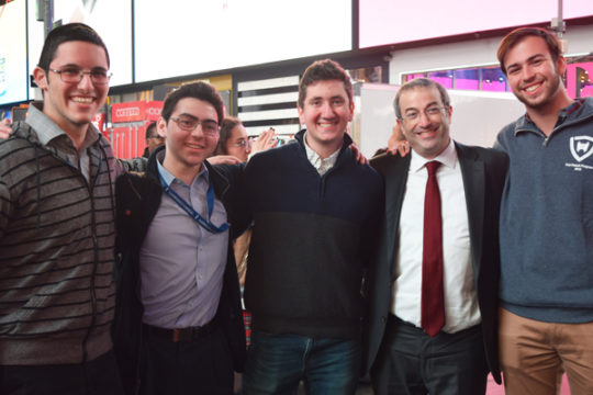 Dr. Ari Berman (second from right) stands with students at the kumzitz in Times Square