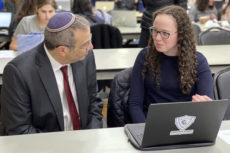 Dr. Ari Berman, President of Yeshiva University, is schooled by Etta Rapp in computer coding