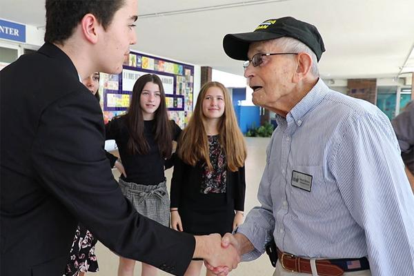 A young student interviews a survivor.