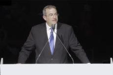 Dr. Berman speaking at the Siyum HaShas