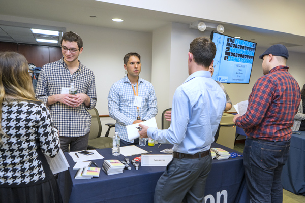 Recruiters from Amazon meet with interested students