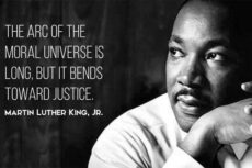 Picture of MLK with arc of justice quote