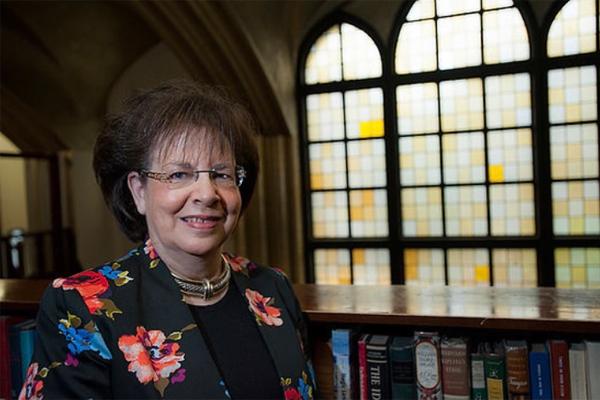 Tova Rosenberg standing in the library at MTA